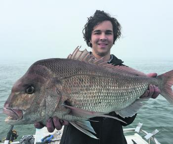 Jason Varadi and his beautiful 7kg top end snapper.