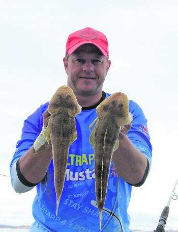 The author with a pair of nice flathead destined for the table.