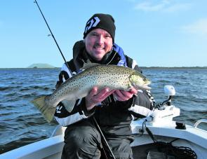 Tom Jarman shows how it is done on Lake Wendouree with a spanking brown trout.