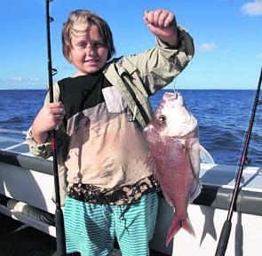Young Aaron with his best snapper to date caught in 90m of water.