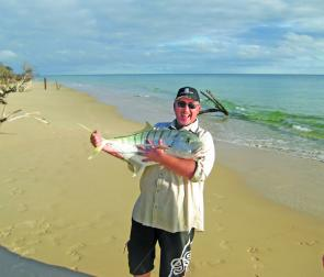 An ecstatic Paul after winning his battle with a 9kg golden trevally.