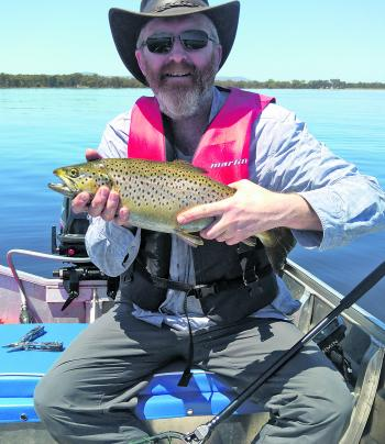 Darrin Pedler with a solid brown trout from Lake Fyans – caught on a redfin pattern bullet lure trolled at slow speed.
