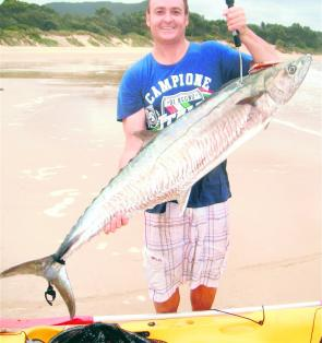 Randell Gibbs with a 17kg-plus Spanish mackerel that took a hard minnow trolled behind his kayak. This was one of the many Spaniards caught in unlikely chocolate water after heavy rain.
