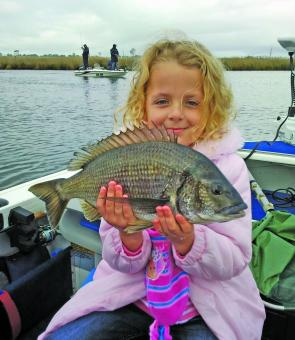 Ainsley Mulligan with a 43cm bream caught on a metal blade.