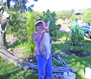 Carol Stephenson shows off her holiday catch of snapper at Laguna bay.