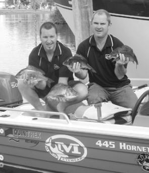Steve Wheeler and his mate about to release some lure-caught bream.