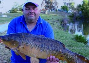 Carp are getting bigger in Lake Burley Griffin. Tom Andrews took this 11kg specimen on a bread and corn bait.