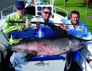 Russell, Kev and Luke with their 73-kilo broadbill swordfish taken off Wollongong.