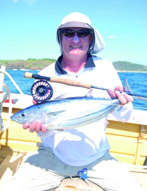 Barry from the Illawarra Fly Fishing Club looks pretty happy with a striped tuna taken on the fly.