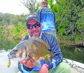 Author Wayne Friebe with a typically fat example of Tasmanian black bream and the Cranka vibes used to catch them.