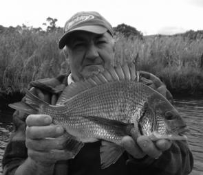 Steve Vail with a Curdies River bream taken on a Berkley Sandworm in camo.