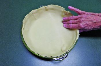 Line the base and sides of a pie/quiche/flan dish with puff pastry. You don't have to lightly oil the dish before you add the puff pastry. Trim any excess pastry from above the lip of the dish (you may omit this step if you prefer a more rustic look).