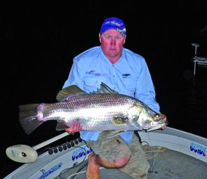 Rob Howell with over 1m of Monduran barra taken on a Tropic Angler TA floater in lumo colour.