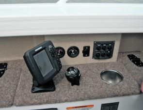 An array of switches plus other items are right at the skipper's fingertips.