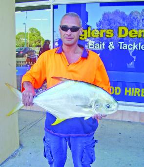 Damien who unwittingly caught a rare 6.2kg snub nosed dart (permit) off the Urangan pier.
