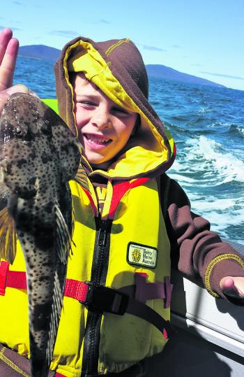 Mason caught this flathead on his great grandfather's 60-year-old rod in the Mercury Passage.