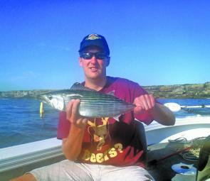 Andrew Humphries with his first bonito, caught while trolling a Rapala CD-7.