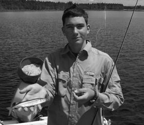 A happy young angler with a fly caught snubbie. Believe it or not the fly will outfish bait once you know what you are doing.