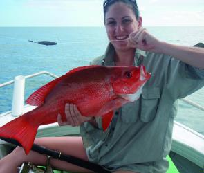 Rachel Hobson shows off her first nannygai taken from the Shoals off Bowen.