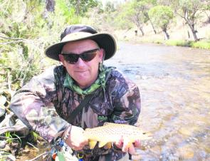 The author with a fat little Mitta Mitta River brown taken on the beetle in six inches of water.