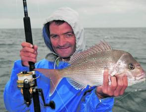 Chris all rugged up and warm with a good quality snapper.