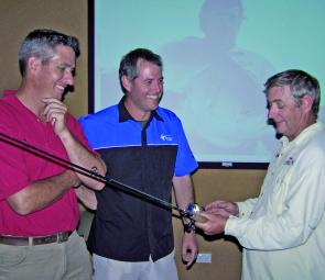 Matt Fraser, Mark Pertot and Trevor Burgess discuss the virtues of various rods and reels at the recent Winter Barramundi seminar hosted by Davo's Bait and Tackle.