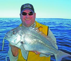 Steve Bain with a Cape Moreton snapper taken on a slow sinking darter shad.