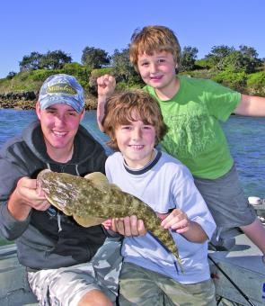 Catching flathead on soft plastics is a great way for kids to learn the basics of fishing.