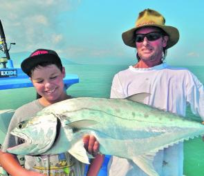 Sharky helps Jordy with a big queenfish.