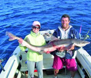 Mel and Kent Hammond show off this giant gummy shark weighing in at 30kg caught offshore.
