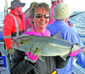Jones Tackle matriarch, Lynn Baxter is the queen of jigging. She is seen here with a typical jig caught school amberjack prior to release.