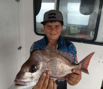 Young Eli Brooks with his PB snapper.