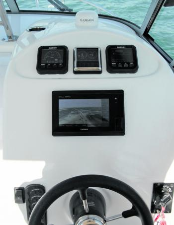 There's room to spare on the dash area for even larger sounders or nav aids. The test boat's layout featured state-of-the-art Suzuki gauges and the Garmin 7407XSV unit, on upper levels wheel and switches lower down.