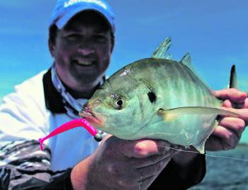 Good mate Blair Bryant with a sold silver trevally, caught while targeting flatties at Lake Tyers.