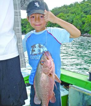 Jacob Standa with his first mangrove jack caught during a hot bite with his dad.