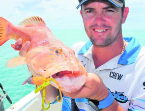 Skipper Luke with a tasty coral trout, which fell to a soft plastic.