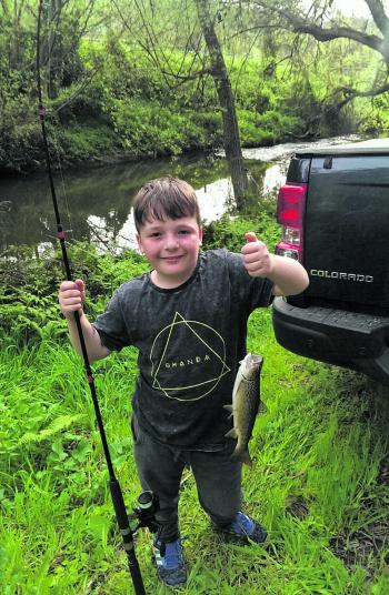 Young Noah with a beautiful 40cm brown trout caught on garden worms.