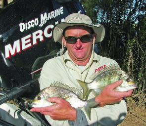 Scott Lane with a pair of the sort of bream the Clarence River is famous for.