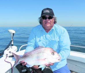 Who says you have to freeze to death to catch snapper? Brett Young with a great chewing-size red.