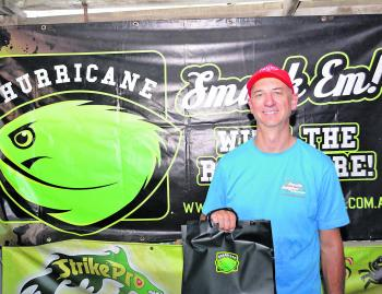 Mario Vukic from Team EGM with his swag of Hurricane lures after winning the Hurricane Monsters Movers Prize.
