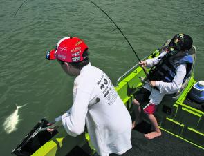 Cody Ward doing battle with a queenfish on 8lb braid while big brother Jacob works the net.