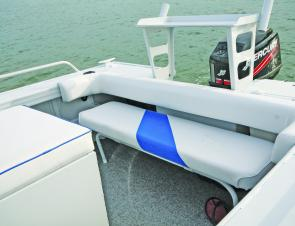 The rear lounge folds away, leaving a padded transom cap. The upholstered seat box has loads of storage.