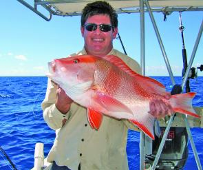 Quentin Pienaar, from Cairns was pretty happy with this red emperor taken while fishing at the reef off Cairns.