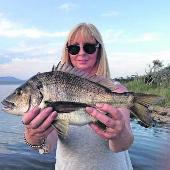 Sue Chapman holding her quality bream.