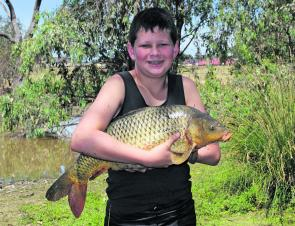 Young Zac Essex with a very fat 68cm European carp caught in a small lagoon in Wangaratta recently. Carp will bite right throughout the heat if January in most areas and are a great way to introduce kids to fishing.