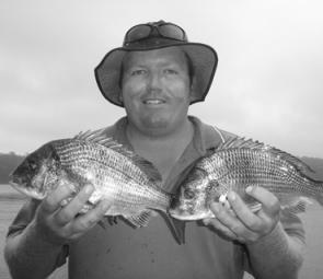 John with two ripper yellowfin bream he caught while fishing Narooma's Wagonga Inlet. Both fish were caught on hard-bodies and released.