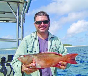 Briggsie was pleased to pull a couple of these coral trout from the western side of Masthead Island (in the background).
