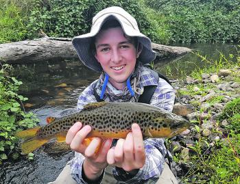 Will O'Connor with a lovely brown trout caught in a small tributary of the Ovens River on a Strike Tiger Nymph soft plastic.