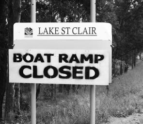 The sign says it all and it's not good news at Lake St Clair, where anglers' only options now are to walk the bank or launch a canoe..