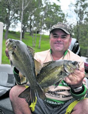Mick Skinner with a brace of Brogo Dam bass. There are also plenty in the river below the dam.